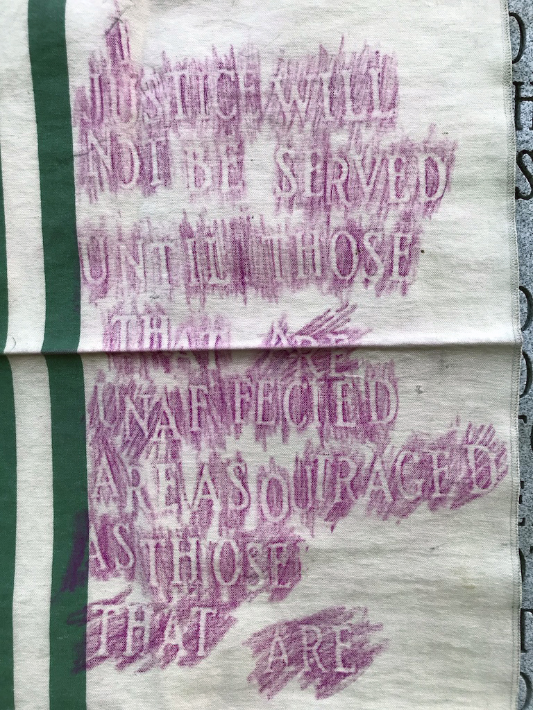 social justice quote rubbing made on moneybag from Trump Plaza using confederate monument in North Carolina