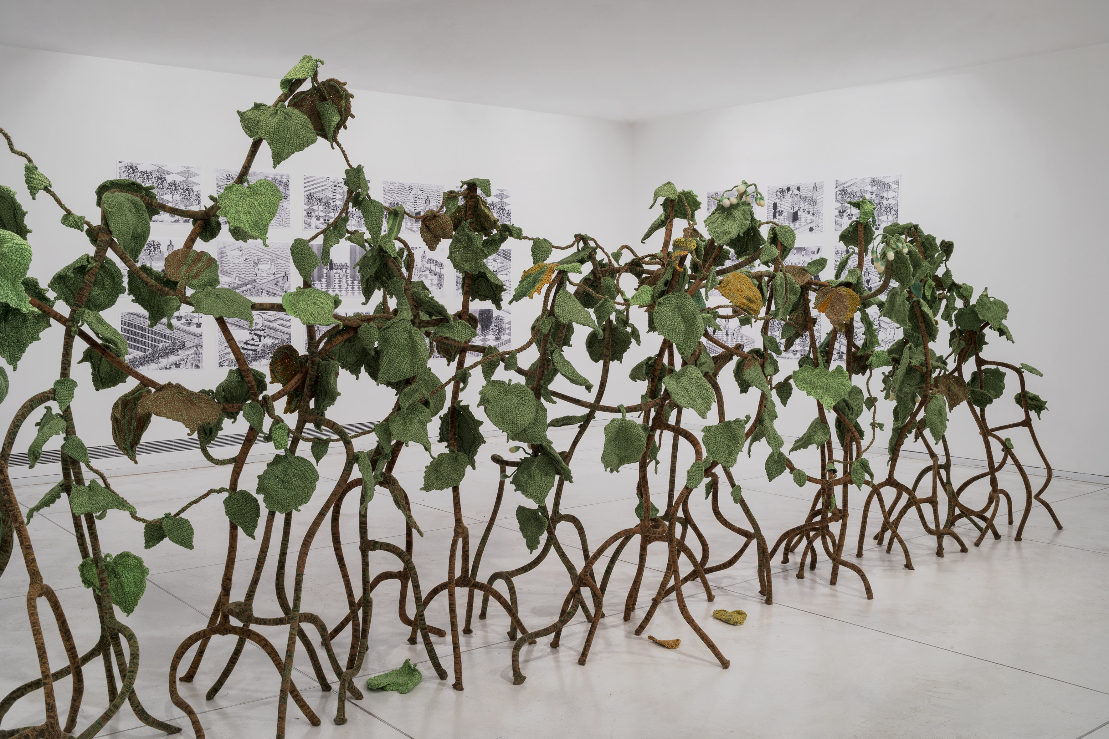 This knitted Hedgerow was created in collaboration with Kuchinate collective - a collective of African Women asylum seekers in Israel who knit for their living, along with 265 volunteers. It reflects on an archival document from 1944 in which the commander of Auschwitz ordered his troops to create a hedgerow which will cover the gas chambers of the camp.