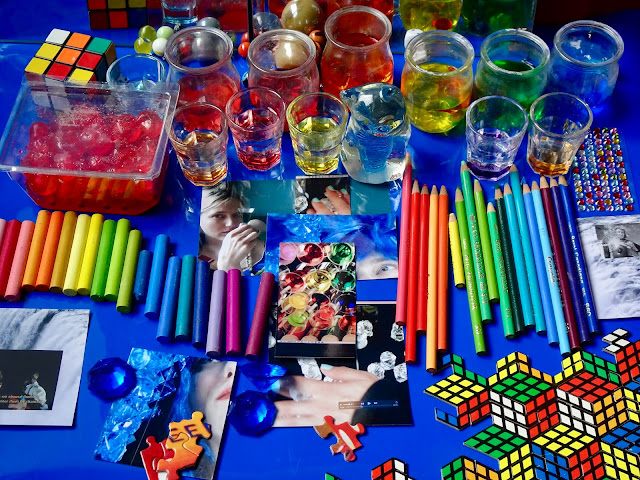 many colored glasses, pencils, and puzzle pieces