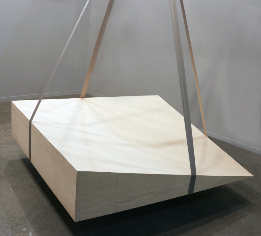 SUSPENDED PLATE is a large wooden monolith, which acts as the tectonic source of vibrations affecting the objects inside CABINET.